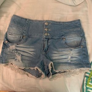 Jean shorts with accented lace trim